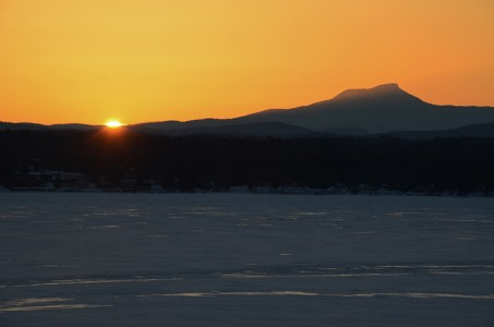 Winter sunrise over Camels Hump on Lake Champlain in Shelburne, Vermont.