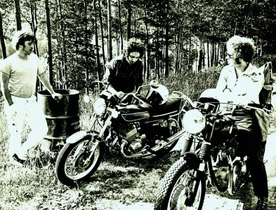 Young men with their motorcycles in Orleans, Vermont