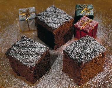 Mouthwatering brownies covered in fudge and powdered sugar