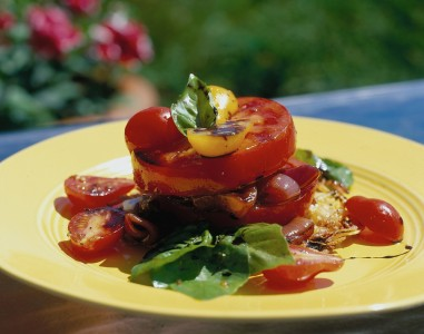 Beautiful vegetable dish with thick, juicy tomatos, fried onions and peppers