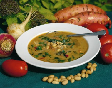 Delicious vegetable soup topped with peanuts
