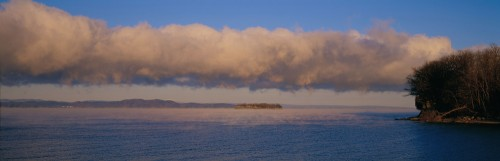 Clouds over Juniper Island on Lake Champlain off the tip of Shelburne Point in Shelburne, Vermont