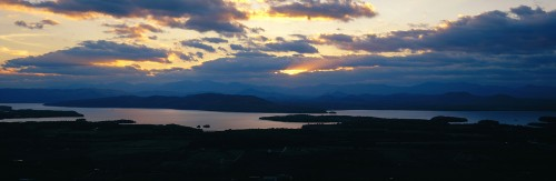 Sunsetting behind Lake Champlain and the Adirondack Mountains in New York from Mount Philo in Charlotte, Vermont