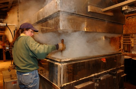 Making maple syrup in a sugar house in Fairfield, Vermont