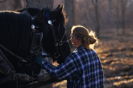 Girl petting her horses in Fairfield, Vermont