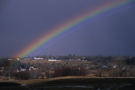 Summer stormy rainstorm with rainbow over the Town of Essex, Vermont.