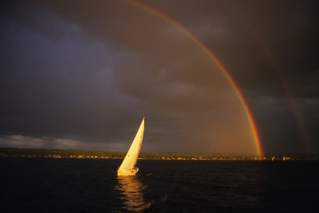 Stormy weather and double rainbows over Shelburne Bayon Lake Champlain in South Burlington Vermont.