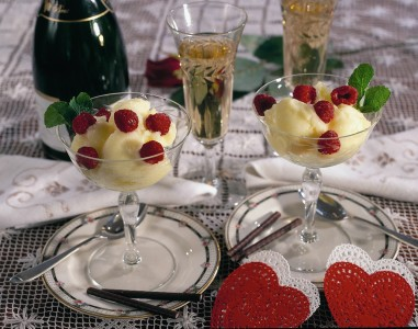 Delicious homemade lemon sorbet garnished with raspberries