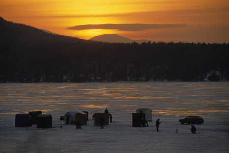 Ice Fishermen and their shanty's on a cold winter day on Lake Champlain in Charlotte, Vermont at the Annual Islands Ice Fishing Derby.