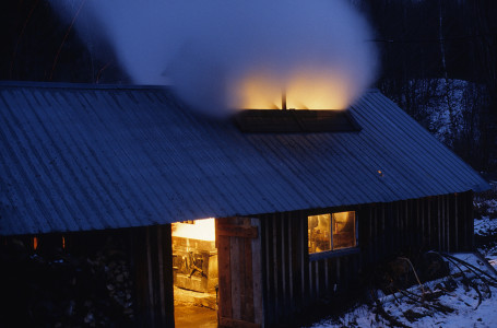 Sugar house with evaporator at full boil in Fairfield, Vermont