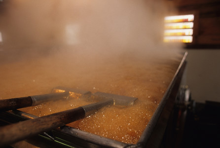 Syrup in an evaporator at a sugar house in Huntington, Vermont
